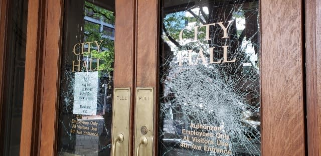 Broken windows at Portland City Hall after a recent protest.